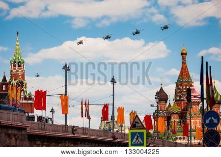 MOSCOW, RUSSIA - MAY 7, 2016: Avia parade in Moscow. Group of Russian helicopters in the sky on parade of Victory in World War II in Moscow, Russia
