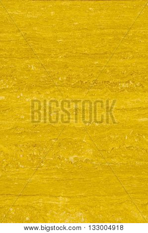 Textured marble background texture pattern with yellowish tones