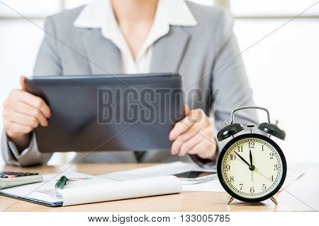 Businesswoman With Tablet Pc In The Stock Market Timing