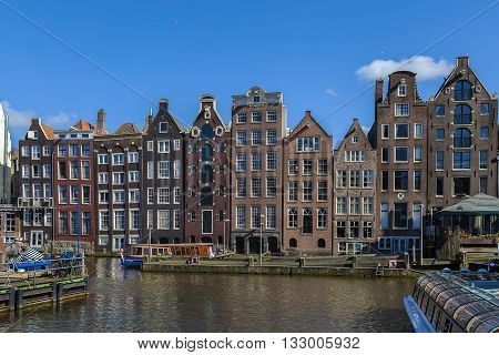The so-called dancing house on the canal Damrak in Amsterdam