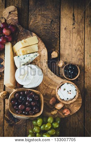 Cheese variety.Food background. Fresh ingredients on wood