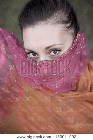 Beautiful brunette portrait wearing traditional indian scarf