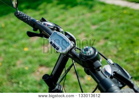 Bike computer on handlebar. Bicycle speed and distance digital measurement tool