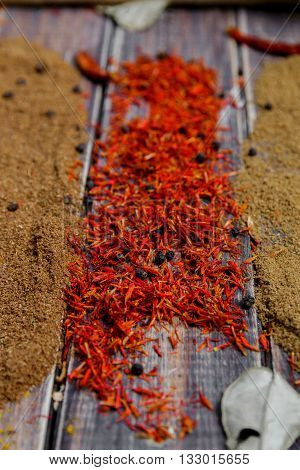 Colourful spices on the table. Various Spices in on wooden background. Spices background. saffron