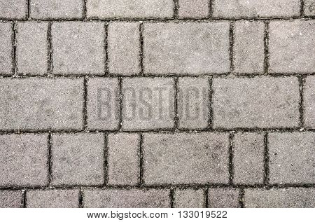 Concrete or cobble gray pavement slabs or stones for floor wall or path. Traditional fence court backyard or road paving.