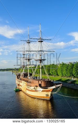 VELIKY NOVGOROD RUSSIA - MAY 25 2015. Summer cityscape with restaurant Frigate Flagship at the river Volkhov at sunset