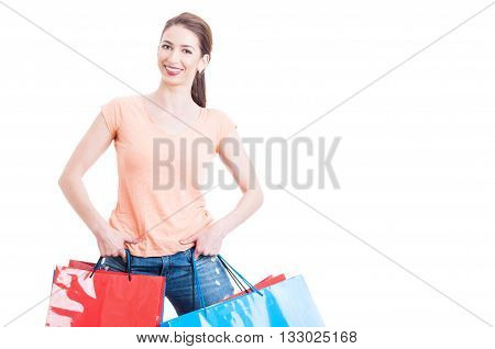 Young Woman With Friendly Face Holding Paper Shopping Bags