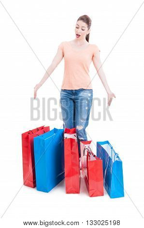 Female Shopper Standing And Feeling Enthusiastic With Many Shopping Bags