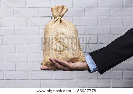 Sack On Hand Black Dollar