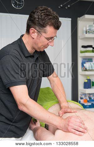 Sports Massage Therapist At Work