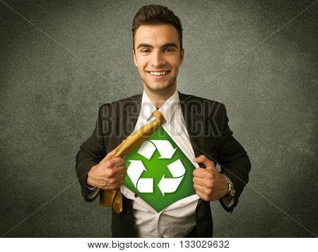 Environmentalist business man tearing off shirt with recycle sign on his chest concept on background