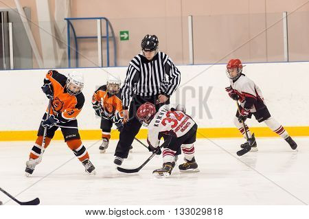 Tyumen, Russia - April 14, 2013: Hockey tournament among teams of children till 9 years old. Game between the Spartakovetc 04-Ekaterinburg and Molot 04-Perm