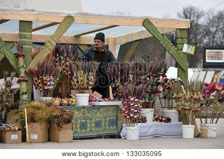 VILNIUS LITHUANIA - MARCH 4: Unidentified people trade traditional palm bouquets in annual traditional crafts fair - Kaziuko fair on Mar 4 2016 in Vilnius Lithuania