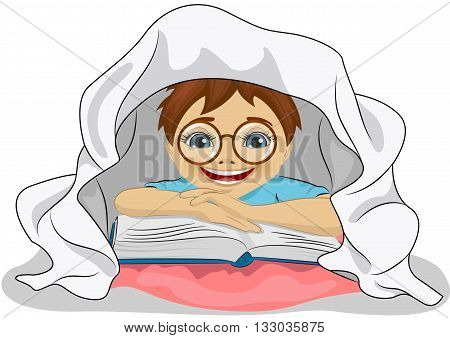 Little boy with glasses reads a book in bed under the blanket