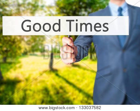 Good Times - Businessman Hand Holding Sign