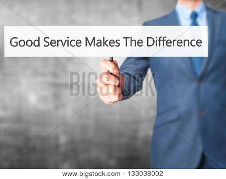 Good Service Makes The Difference  - Businessman Hand Holding Sign