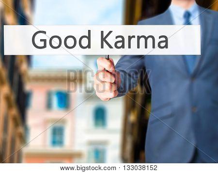 Good Karma - Businessman Hand Holding Sign