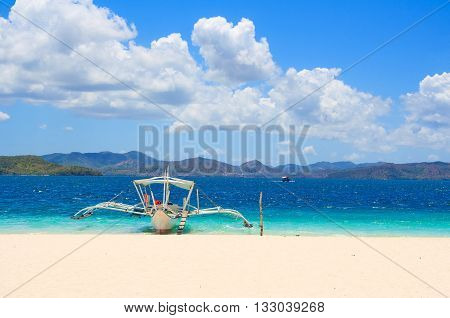 Traditional Philippine boat on the beach. Island bananas. Philippines.