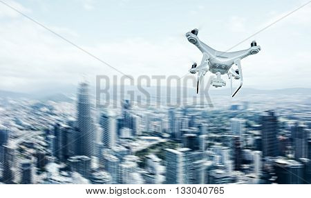 Photo White Matte Generic Design Remote Control Air Drone with action camera Flying Sky under City. Modern Megapolis Background. Horizontal, back side view. Motion Blur Effect. 3D rendering