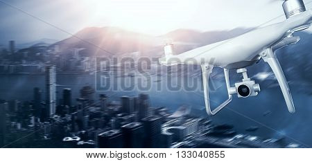 Photo White Matte Generic Design Remote Control Air Drone with action camera Flying Sky under City. Modern Megapolis Sunset Background. Wide, front side view. Motion Blur Effect. 3D rendering