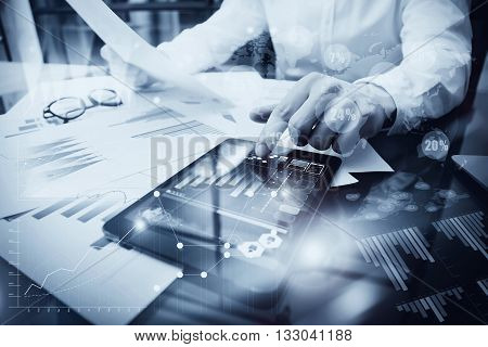 Risk Management Work process.Picture Trader working Market Report Document Touching Screen Tablet.Using Worldwide Graphic Icons, Stock Exchange Reports.Business Project Startup.Horizontal, Black white