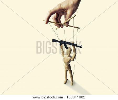 A puppet with gun in the hands of the tyrant on the isolated toned background