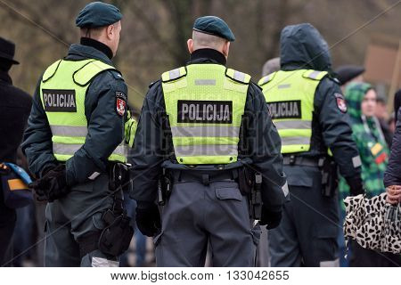 VILNIUS LITHUANIA - MAR 11: Police officers on duty in a nationalist rally at Gedimino Avenue on Re-Establishment of Independence Day on March 11 2016 in Vilnius Lithuania