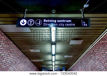 Oslo Norway - February 28 2016: Oslo subway (Norwegian T-banen i Oslo). Sign leading to the city centre.