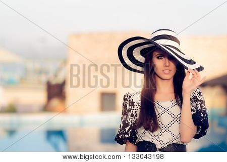 Happy Summer Woman With Big Sunhat by the Pool