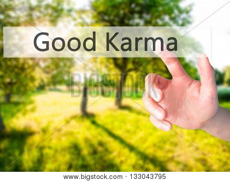 Good Karma - Hand Pressing A Button On Blurred Background Concept On Visual Screen.