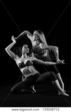 The flexible Duo of dancers on a dark background