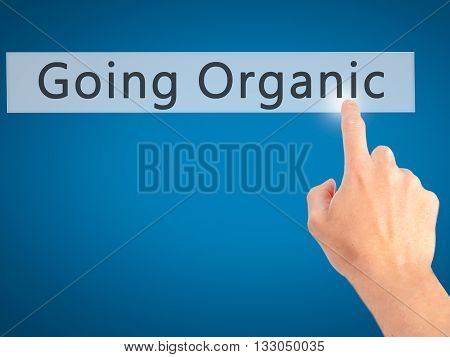 Going Organic - Hand Pressing A Button On Blurred Background Concept On Visual Screen.