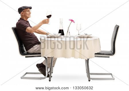 Senior gentleman tasting red wine and looking at the glass isolated on white background