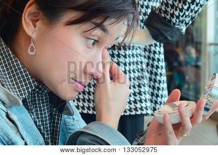 Asia woman makeup your face. Make-up closeup. Cosmetic Powder Brush.