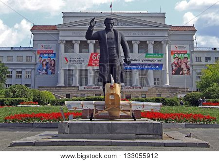Yekaterinburg Russia - July 20 2015: monument of Kirov against background of the main building of Ural Federal University in Yekaterinburg