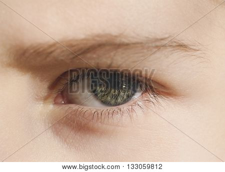 Closeup of the human eye. frowning girl