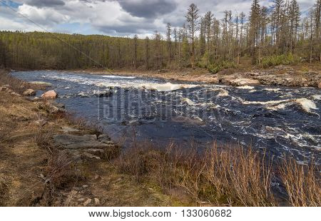 The rapids on the turbulent mountain river in South Yakutia Russia