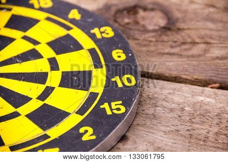 Darts dartboards on a brown wooden Board. Table for the game of Darts. the success failure of the business concept. Closeup. place for text