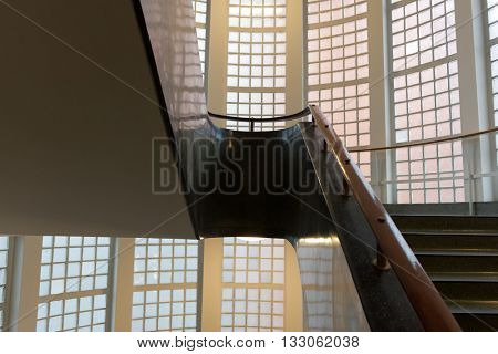 SCIENCE MUSEUM, LONDON - FEBRUARY 08, 2016: Futuristic staircase dressed with polished railings and surrounded by with cylindrical walls. London, UK on February 08, 2016.