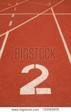 The number 2 on a running track