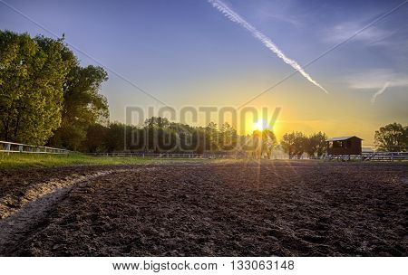 Outdoor parade ground of Stud at sunrise. Country view.