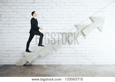 Success concept with businessman walking up abstract concrete arrow stairs on white brick background. 3D Rendering