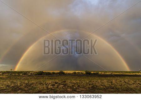 Double rainbow over Texas landscape