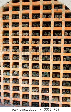 vintage wine bottles stacked in the wine cellar