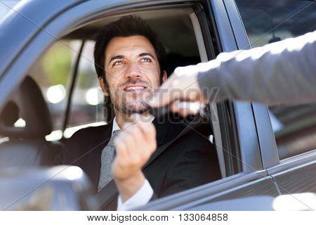 Man taking car key