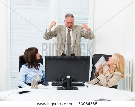 Businessman shouting at his employees