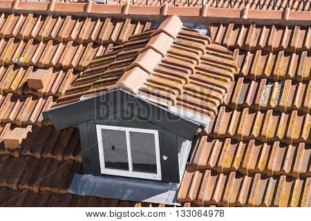 Red terracotta roof tiles on a rooftop in Lisbon Portugal