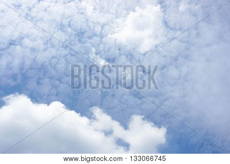Puffy white cloud with deep blue sky