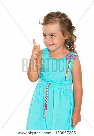 Fancy a little fair-haired girl with beautiful hair on his head, dressed in a blue dress , threatening finger . close-up - Isolated on white background