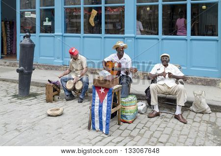 HAVANA - DECEMBER 10: Elderly street musicians playing traditional cuban music on the street in old Havana on 10 December 2015 in Havana, Cuba.